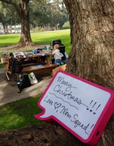 Mom Squad gathered at a Seal Beach park and worked together wrapping all the gifts they purchased
